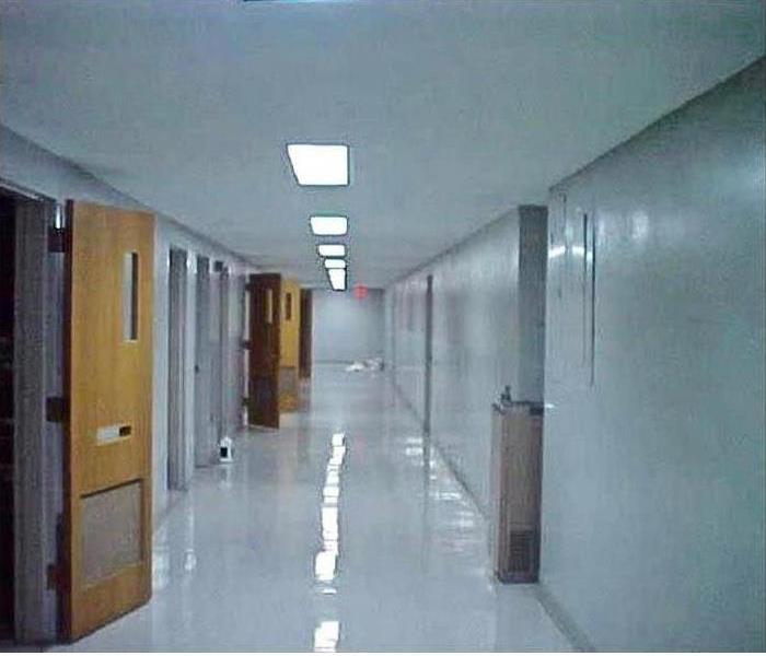 the corridor is sparkling clean, no evidence of a fire