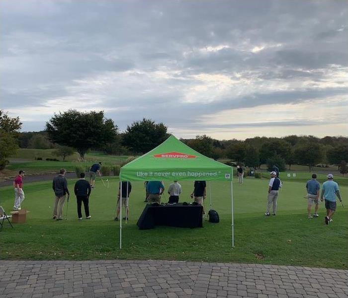 golf course with SERVPRO tent set-up