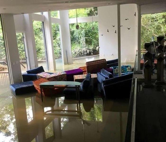 photo of feet of water in a living room of house