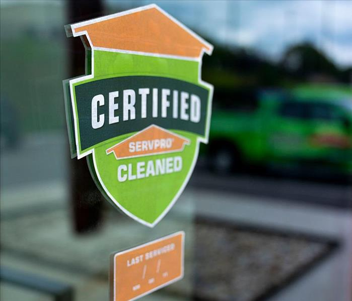 Certified: SERVPRO Cleaned window decal on glass door of business